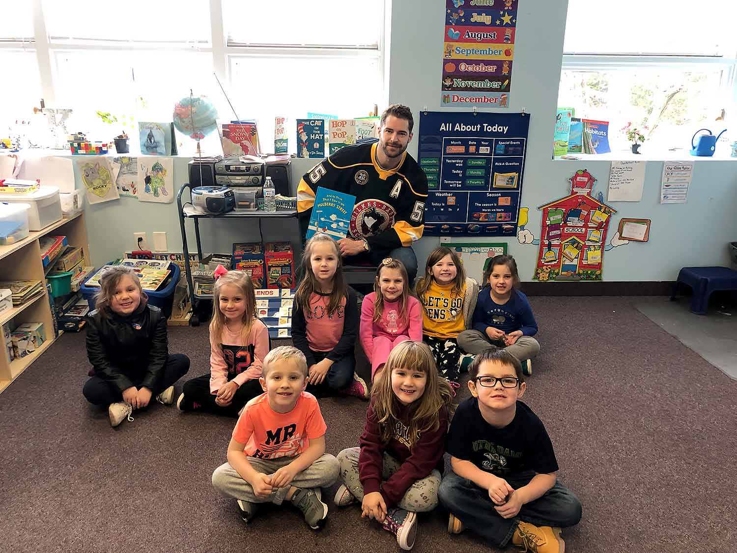 CHRIS SUMMERS FROM THE WILKES-BARRE PENGUINS VISITS I'M BIG NOW FOR READ ACROSS AMERICA WEEK